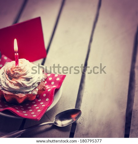 Holidays background with Birthday cupcake/ Birthday greeting card with cupcake and candle - stock photo