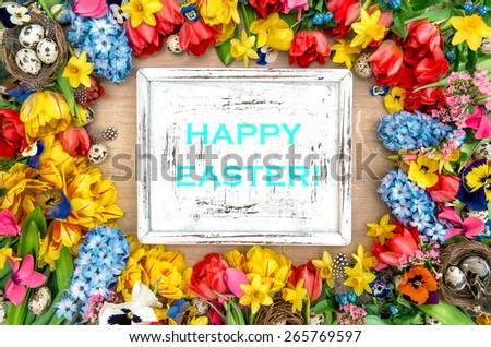 Holidays background with spring flowers, easter eggs and white wooden desk for your text. Vintage shabby chic style. Happy Easter! - stock photo