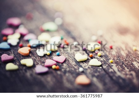Holidays card with small hearts on wooden background / romantic love background/ selective focus - stock photo