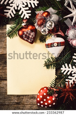 Holidays decoration and blank paper on wooden background  - stock photo