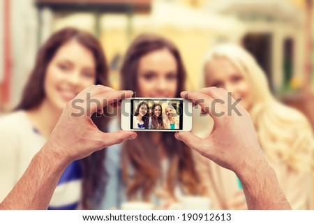holidays, electronics and tourism concept - close up of man hands taking picture with smartphone camera - stock photo