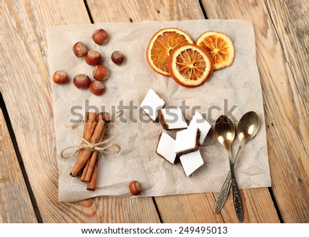 Holidays, food and drink concept. Assortment of handmade cookies and spices on a wooden a table. Top view - stock photo