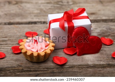Holidays gift,cake and red heart on wooden background. Valentines day background. - stock photo