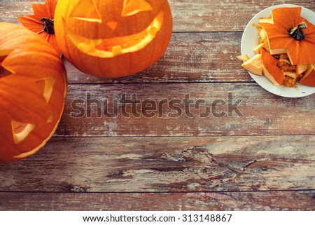 holidays, halloween and decoration concept - close up of pumpkins on table with copy space - stock photo