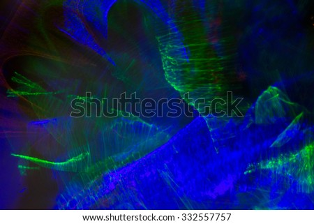 holidays, illumination and electricity concept - blue green night lights bokeh over dark background - stock photo
