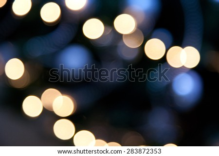 holidays, illumination and electricity concept - colorful bright lights on dark blue night background - stock photo