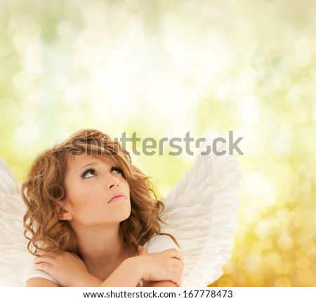holidays, love and costumes concept - unhappy teenage angel girl - stock photo