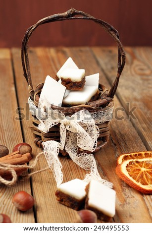 Holidays, love, food and drink concept. Handmade cookies in a basket on a wooden table. Selective focus - stock photo