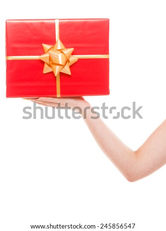 holidays love happiness concept - big red gift box in female hand. Woman holding christmas present isolated on white - stock photo