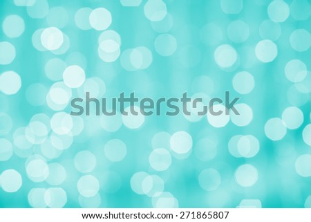 holidays, party and celebration concept - blurred green blue background with bokeh lights - stock photo
