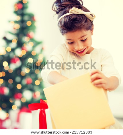 holidays, presents, christmas, x-mas concept - happy child girl with gift box - stock photo