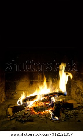 Holidays relaxation concept.Spurts of flame in chimney place. fireplace, resting card template. Evening time. Fiery. Flames of fire. Realistic, beauty fire. Black background, copy space. - stock photo