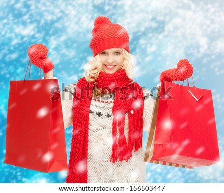 holidays, sale, shopping, christmas concept - beautiful teenage girl in winter clothes with shopping bags - stock photo