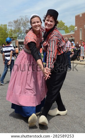 HOLLAND, MI - MAY 3: Tulip Time Festival dancers pose after performing the mother-daughter dance in Holland, MI May 3, 2015.  - stock photo