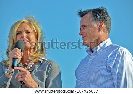 HOLLAND, MICHIGAN - JUNE 19: Mitt and Ann Romney during a campaign rally at Holland State Park on June 19, 2012 in Holland, Michigan. - stock photo