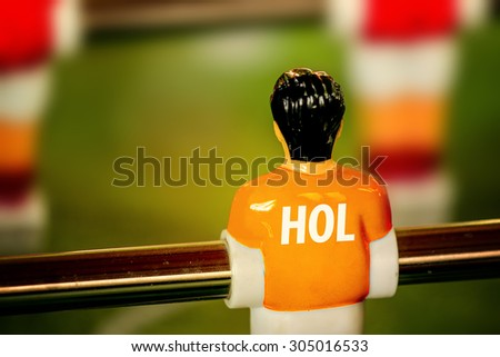 Holland National Jersey on Vintage Foosball, Table Soccer or Football Kicker Game, Selective Focus, Retro Tone Effect - stock photo