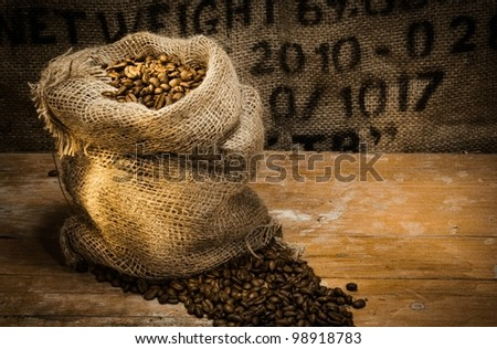 Hollow woven bag full of coffee under beautiful lighting - stock photo