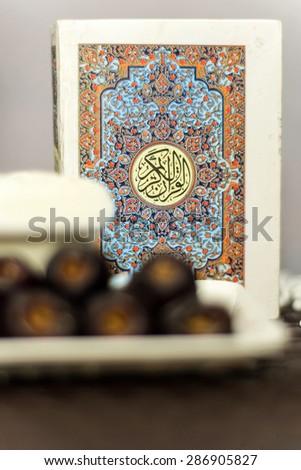 Holly Quran , yogurt and dates  - stock photo