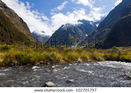 Hollyford River valley in Fjordland National Park, Southern Alps, New Zealand - stock photo