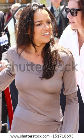 HOLLYWOOD - AUGUST 26, 2013: Michelle Rodriguez speaks at Walk of Fame ceremony where Vin Diesel  receives a star in front of the Roosevelt Hotel August 26, 2013 Hollywood, CA. - stock photo