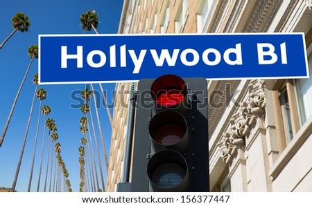 Hollywood Boulevard redlight sign illustration on palm trees background - stock photo