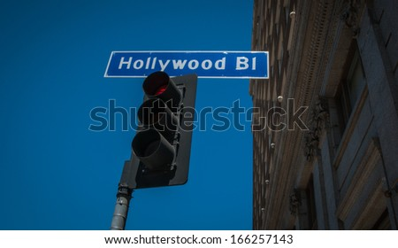 Hollywood  Boulevart street sign with traffic lights 2013 - stock photo