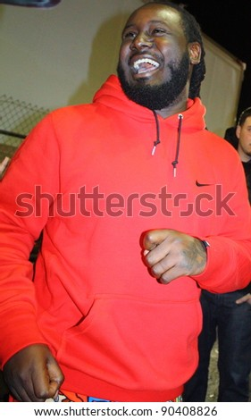 HOLLYWOOD CA - DECEMBER 6: Rapper T-Pain signs autographs after an appearance on the Jimmy Kimmel Show outside the Jimmy Kimmel studios December 6, 2011 - stock photo