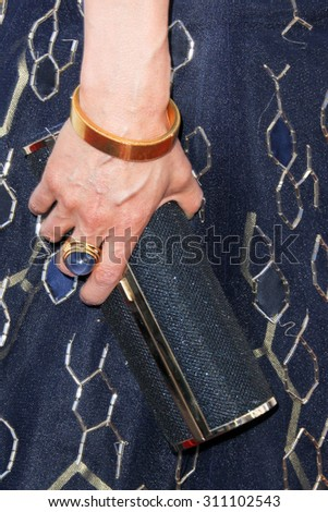 HOLLYWOOD, CA-JUN 1: Actress Lucy Liu holds a purse at  the 2014 Huading Film Awards at The Montalban on June 1, 2014 in Hollywood, California. - stock photo