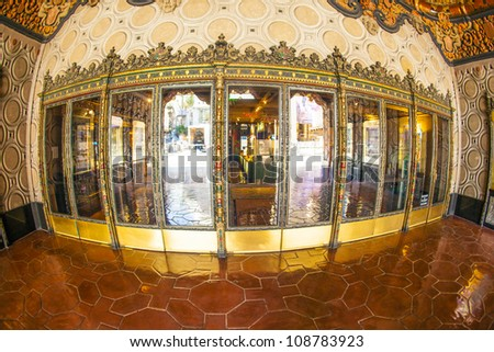 HOLLYWOOD, CA- JUNE 26: entrance of El Capitan Theatre, June 26, 2012 in Hollywood,CA. In the 1940s, 1735 Vine was renamed The El Capitan Theatre. It is running as cinema nowadays. - stock photo