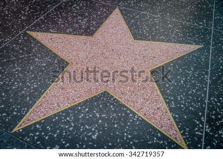 HOLLYWOOD,CA - OCTOBER 8,2015: empty star on Hollywood Walk of Fame in Hollywood, California. This star is located on Hollywood Blvd. and is one of 2400 celebrity stars. - stock photo