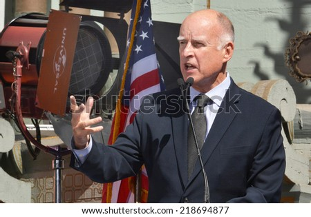 HOLLYWOOD, CA - SEPTEMBER 18, 2014: California Governor Jerry Brown gestures as he speaks at the signing of the California Film and Television Job Retention Act in Hollywood, CA on September 18, 2014. - stock photo
