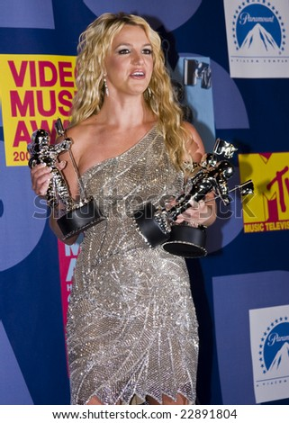 HOLLYWOOD, CA - SEPTEMBER 07: Singer BRITNEY SPEARS poses with Moonman Awards in the press room at the 2008 MTV Video Music Awards at Paramount Studios on September 7, 2008 in Hollywood, California. - stock photo