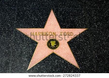HOLLYWOOD, CA/USA - APRIL 18, 2015: Harrison Ford star on the Hollywood Walk of Fame. The Hollywood Walk of Fame is made up of brass stars embedded in the sidewalks on Hollywood Blvd. - stock photo