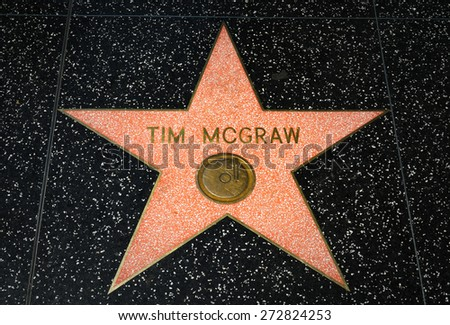 HOLLYWOOD, CA/USA - APRIL 18, 2015: Tim McGraw star on the Hollywood Walk of Fame. The Hollywood Walk of Fame is made up of brass stars embedded in the sidewalks on Hollywood Blvd. - stock photo