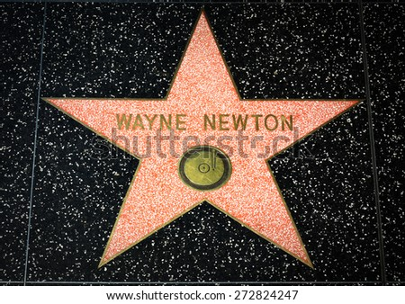HOLLYWOOD, CA/USA - APRIL 18, 2015 Wayne Newton star on the Hollywood Walk of Fame. The Hollywood Walk of Fame is made up of brass stars embedded in the sidewalks on Hollywood Blvd. - stock photo