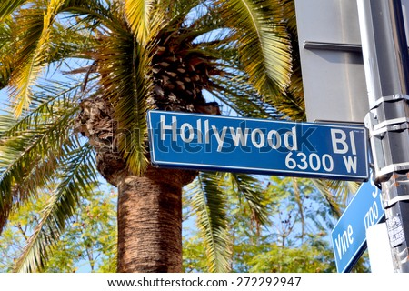 HOLLYWOOD CA USA 04 13 2015: Hollywood boulevard street sign. In 1958, the Hollywood Walk of Fame, was created as a tribute to artists working in the entertainment industry. - stock photo