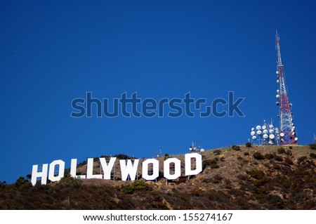HOLLYWOOD, CA/USA - MARCH 17 2007: Hollywood sign celebrates its 90th anniversary in September 2013. Located on Mount Lee in Hollywood Hills in Los Angeles, its the worldwide symbol of entertainment - stock photo