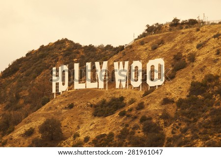HOLLYWOOD, CA/USA - MAY 22, 2015: A view of the iconic Hollywood sign in the Santa Monica hills outside of Los Angeles and Hollywood, California. Created as advertisement for real estate development. - stock photo