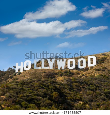 HOLLYWOOD CALIFORNIA - APRIL 12, 2013: Located in Hollywood Hills at Mount Lee the world famous landmark Hollywood Sign in Los Angeles, California on April 12, 2013. Sky clouds are digital improved. - stock photo