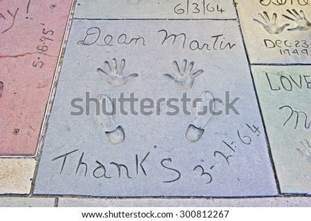 HOLLYWOOD - CALIFORNIA, AUG. 15, 2014: Hand and Foot imprints with inscription in concrete of famed movie star Dean Martin at Graumans Chinese Theater in Hollywood, California USA - stock photo