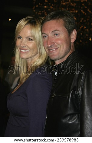 """HOLLYWOOD, CALIFORNIA. August 23, 2005. Janet Jones and Wayne Gretzky at the World Premiere of """"Dirty Deeds"""" at the Directors Guild of America in Hollywood, California , United States. - stock photo"""