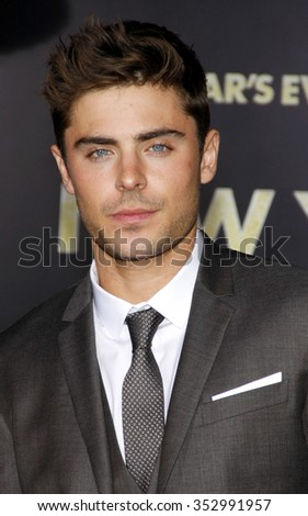 "HOLLYWOOD, CALIFORNIA - December 5, 2011. Zac Efron at the Los Angeles premiere of ""New Year's Eve"" held at the Grauman's Chinese Theater, Los Angeles.  - stock photo"