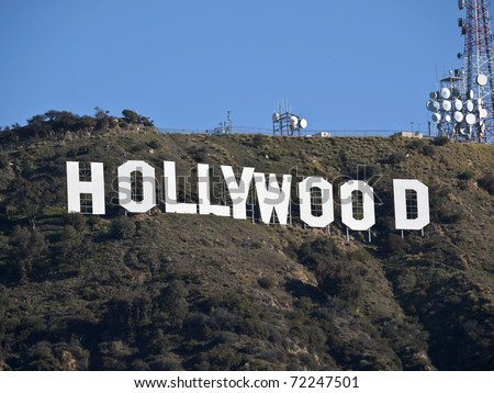 HOLLYWOOD, CALIFORNIA - February 27:  Hugh Hefner donates money to the Hollywood sign trust to protect 138 acres behind the sign from development, on February 27, 2011 in Los Angeles, California. - stock photo