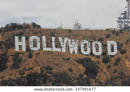 HOLLYWOOD, CALIFORNIA - JULY 15: Hollywood sign on mountains in Los Angeles July 15, 2011 in Los Angeles, USA. Originally created as advertisement for real estate development. - stock photo