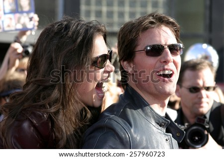 "HOLLYWOOD, CALIFORNIA. June 27, 2005. Tom Cruise and Katie Holmes at the ""War of the Worlds"" Fan Screening at the Chinese Theater in Hollywood. - stock photo"