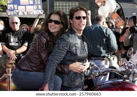 "HOLLYWOOD, CALIFORNIA - June 27 2005. Tom Cruise and Katie Holmes attend at the ""War of the Worlds"" Fan Screening at the Chinese Theater in Hollywood, California. - stock photo"