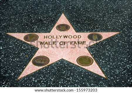 HOLLYWOOD - CALIFORNIA 26: The iconic Hollywood Walk of Fame on the floor with icons of the music, film, television, radio and acting industries, on September 26, 2013. - stock photo