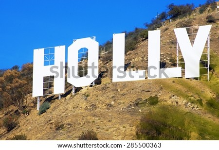 HOLLYWOOD, CALIFORNIA, USA - FEBRUARY 5, 2014: Section of the Hollywood sign, built in 1923, located in Hollywood Hills at Mount Lee. A world famous landmark of Hollywood and the City of Los Angeles. - stock photo