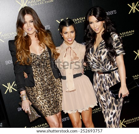 HOLLYWOOD, CALIFORNIA - Wednesday August 17, 2011. Khloe Kardashian, Kourtney Kardashian and Kim Kardashian at the Kardashian Kollection Launch Party held at the Colony, Los Angeles. - stock photo