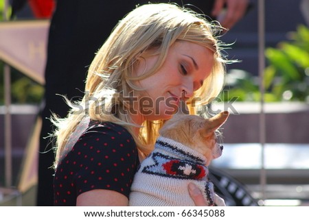 HOLLYWOOD - DECEMBER 1: Actress Reese Witherspoon and Bruiser the Chihuahua celebrating her star on the Hollywood Walk of Fame December 1, 2010 in Hollywood, CA. - stock photo